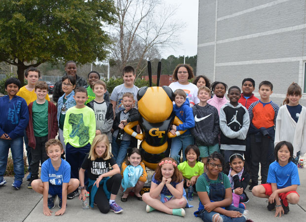K-12 STEM students with Buzz