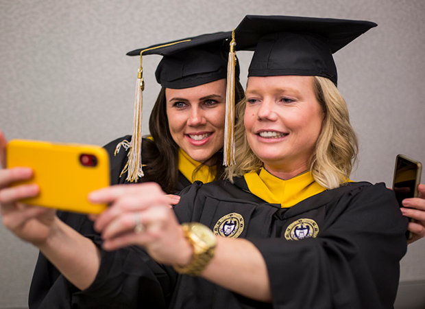 PMOSH graduates taking selfie