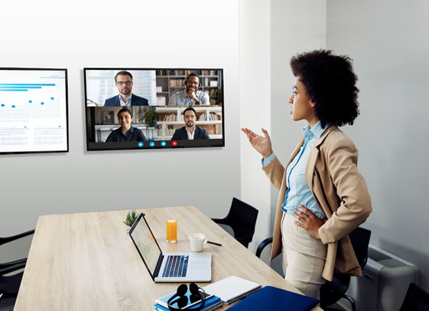 Event presenter leading a hybrid event from both the conference room and livestream