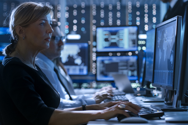 Cyber security professional working in data security center