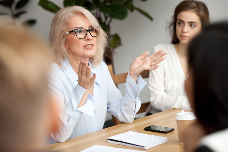 Female professional leading a business meeting