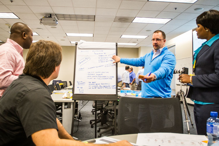 Supply chain professionals collaborating during course