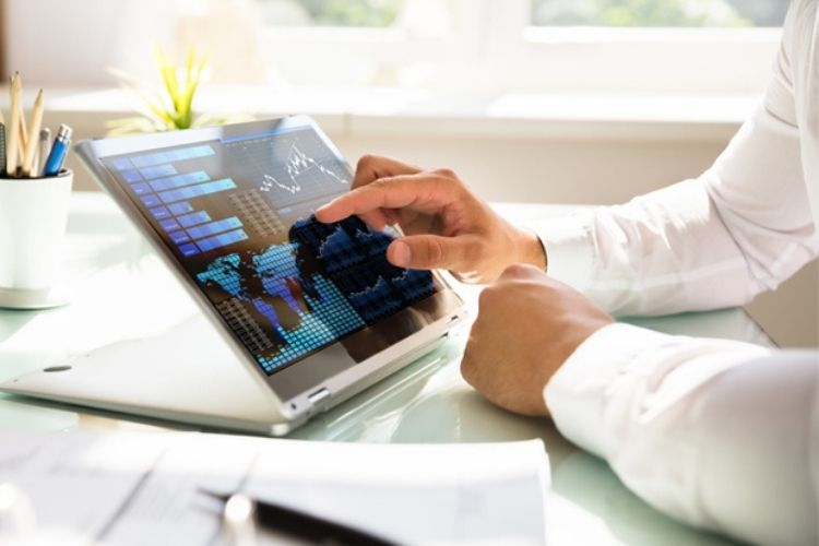 Working professional reviewing data on tablet computer