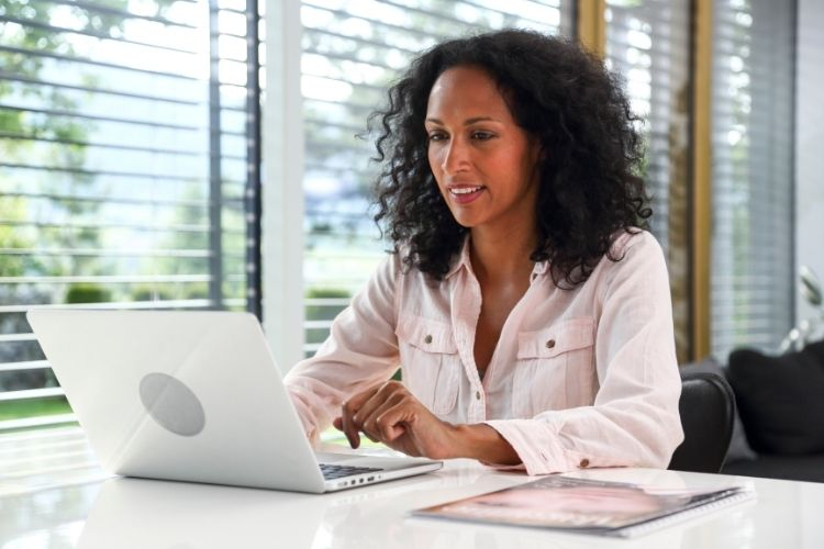 African American working professional working and learning on laptop computer