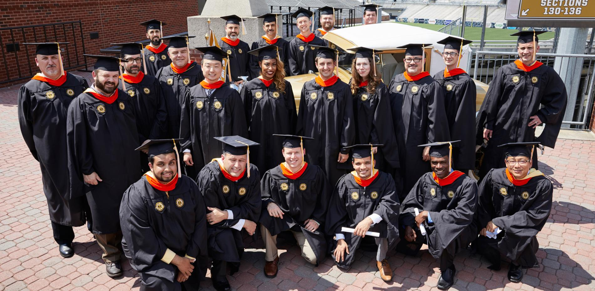 Group of Georgia Tech graduates posing in their caps and gowns