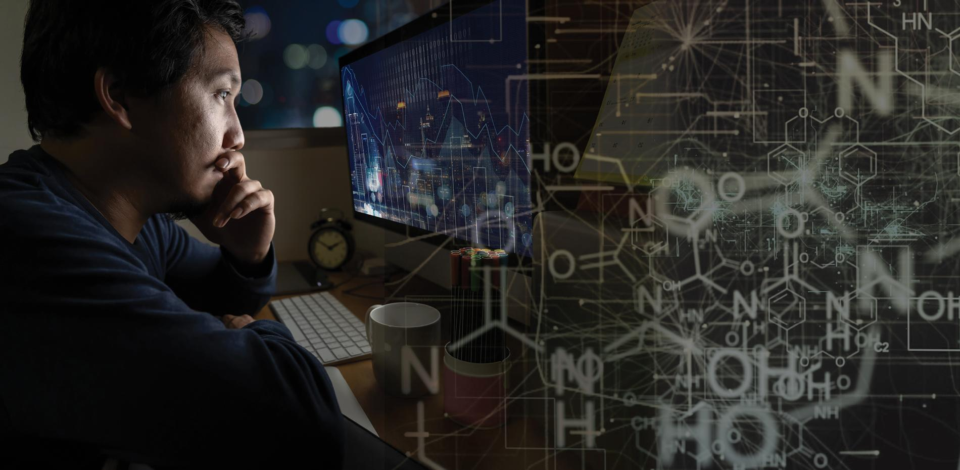 Adult male looking at computer screen with an overlay of chemical engineering formulas across the screen.