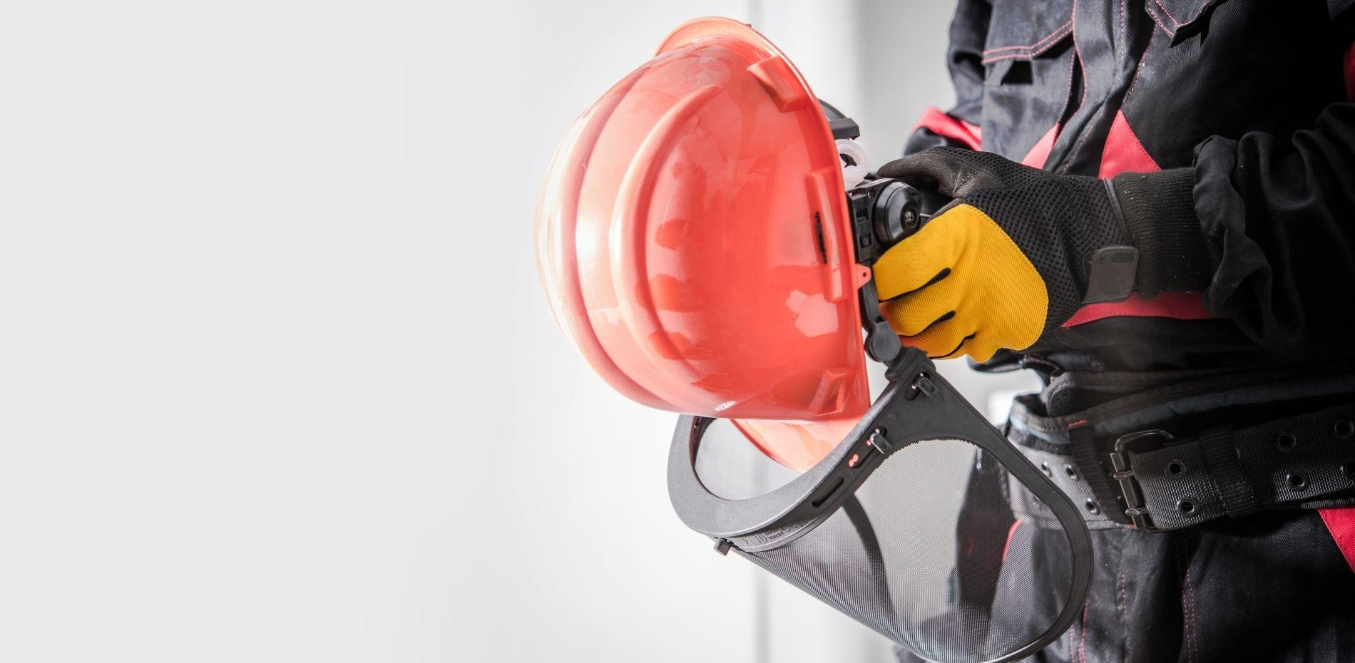 OSHA professional wearing personal protective equipment at work.